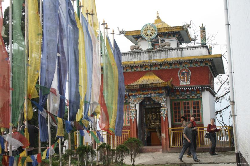 Main_Shrine_of_Pemangytse_Gompa_with_prayer_flags